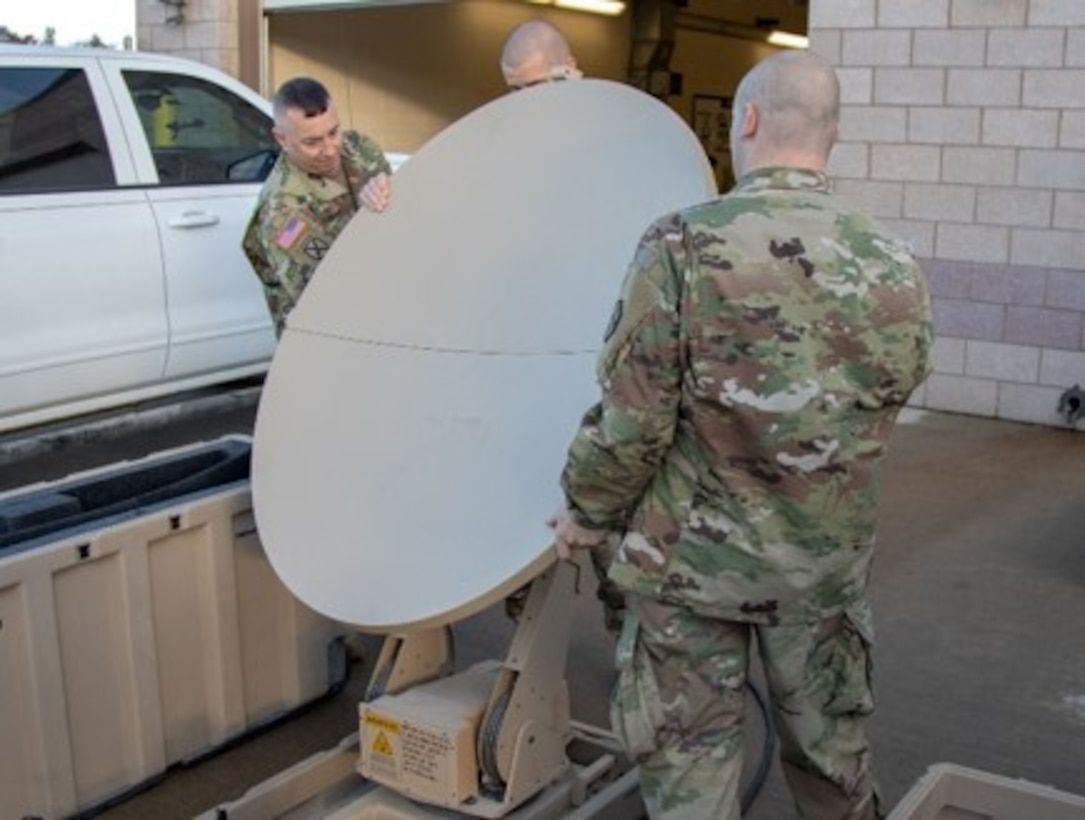 """Personnel from the 364th ESC's SAMSO conducted a three-day staff assistance visit to the 652nd RSG in Helena, Montana, to ensure that not only the unit's VSATs and CAISI equipment are fully mission capable and current on all software, but that operators are also trained in the setup, operation and tear down of the VSAT. Equipment upgrade was critical to the VSAT and CAISI laptops, given without it they be non-mission capable.  """"The Soldiers worked hard on grasping the cumbersome job of setting up the VSAT, and were able to set it up to standard. They were very highly motivated, and took ownership of maintaining their equipment,"""" said Chief Warrant Officer 3 James Randazzo of the 364th ESC."""