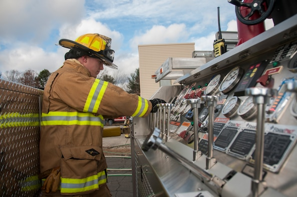 Senior Airman Dylan Nygren, 104th Civil Engineering Squadron firefighter, participates in live structural fire training Nov. 27, 2018, at Barnes Air National Guard Base, Massachusetts. The training ensures the Fire Attack Teams are prepared to respond to any fires on base or in the surrounding communities. (U.S. Air National Guard photo by Airman 1st Class Randy Burlingame)