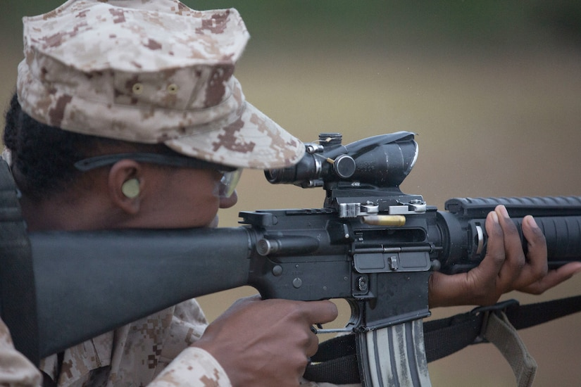 A Marine Corps recruit uses a weapons range.