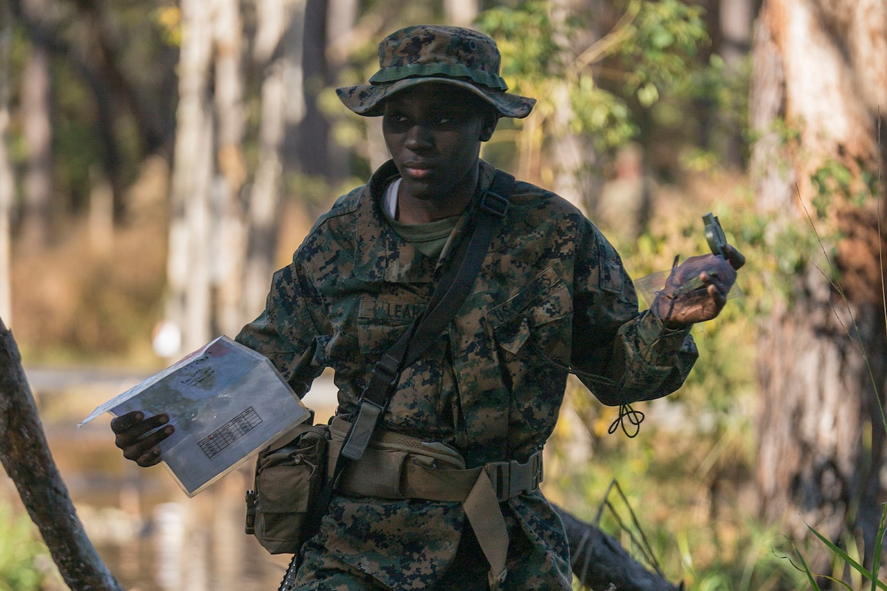 A Marine Corps recruit conducts land navigation.