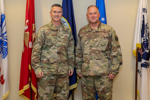 Army Command Sgt. Maj. Paul Biggs (left), Senior Enlisted Leader for Futures and Concepts Center, a subordinate organization of Army Futures Command in Austin, TX., poses for a photo with Air Force Chief Master Sgt. James Brown (right), Senior Enlisted Leader for Joint Task Force Civil Support (JTF-CS), at the JTF-CS headquarters at Fort Eustis. Futures and Concepts Center is located at Army Training and Doctrine Command, also headquartered at Fort Eustis and adjacent to JTF-CS. The visit was held to foster friendship and teamwork between the military neighbors. (Official DoD photo by Navy Petty Officer Third Class Michael Redd/released)