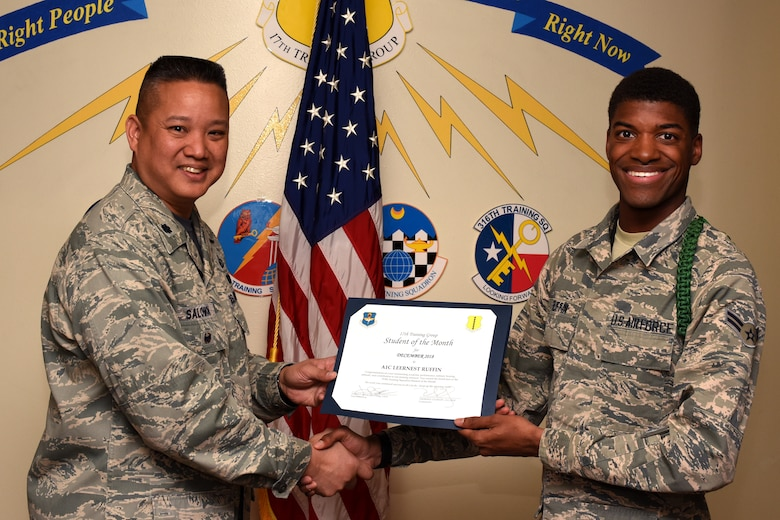 U.S. Air Force Col. Abraham Salomon, 17th Training Group deputy commander, presents the 315th Training Squadron Student of the Month award to Airman 1st Class Leernest Ruffin, 315th TRS student, at the Brandenburg Hall on Goodfellow Air Force Base, Texas, Jan. 4, 2019. The 315th TRS's vision is to develop combat-ready intelligence, surveillance and reconnaissance professionals and promote an innovative squadron culture and identity unmatched across the U.S. Air Force. (U.S. Air Force photo by Airman 1st Class Zachary Chapman/Released)