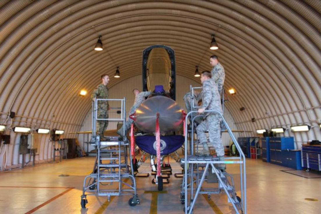 "Egress Technicians from the 31st Maintenance Group, Aviano Air Base Italy, prepare a U.S. Air Force F-16 Falcon for Aviano's first ""Super Raise"" procedure, October 2, 2018. (U.S. Air Force Courtesy Photo)"