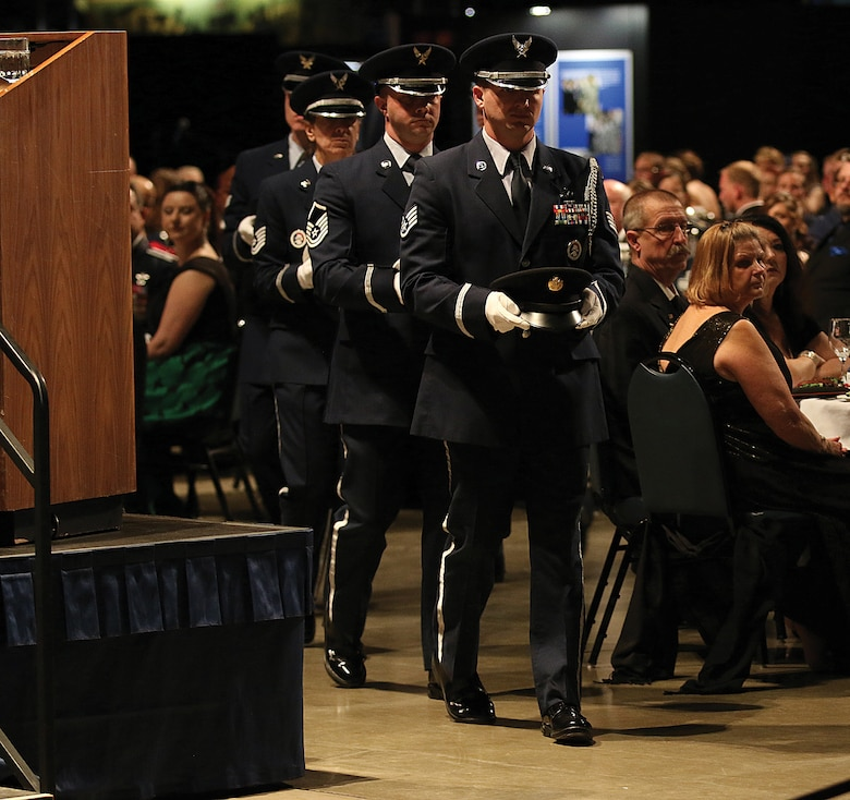 The 445th Airlift Wing Honor Guard performs a solemn POW/MIA table ceremony during the 445th AW annual awards banquet April 7, 2018.