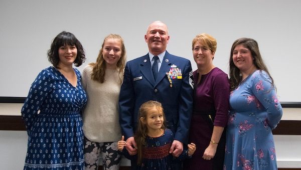The family and friends of Chief Master Sgt. Fred Turner pose for a photo following a formal retirement ceremony held in his honor Jan. 4, 2019, at McLaughlin Air National Guard Base, Charleston, W.Va. Turner served in the California and West Virginia Air National Guard for 41 years cumulatively and was also the 12th State Command Chief for the West Virginia Air National Guard. (U.S. Air National Guard photo by Master Sgt. De-Juan Haley)
