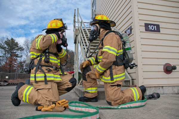 Airman 1st Class Thomas Ruffo and Senior Airman Dylan Nygren, 104th Civil Engineering Squadron firefighters, participate in live structural fire training Nov. 27, 2018, at Barnes Air National Guard Base, Massachusetts. The training ensures the Fire Attack Teams are prepared to respond to any fires on base or in the surrounding communities.