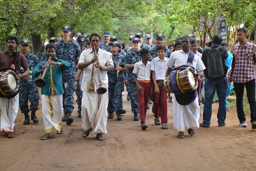 Sailors are greeted by locals.