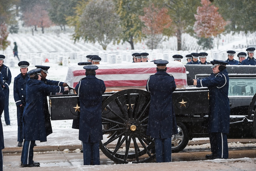 Members of the U.S. Air Force casket team prepares to lift the casket of the late Chief Master Sgt. Therese Henrion during a burial ceremony at Arlington National Cemetery, Nov. 15, 2018.