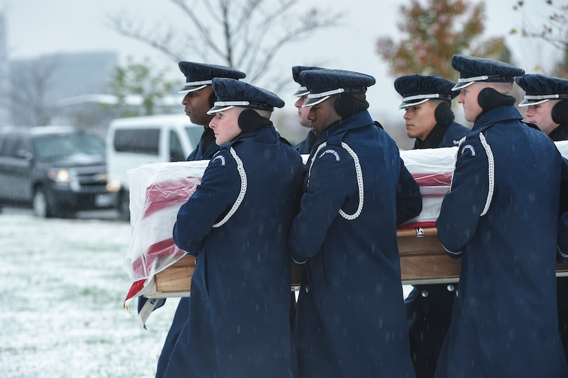 The U.S. Air Force casket team carries the casket of the late Chief Master Sgt. Therese Henrion, Nov. 15, 2018, at Arlington National Cemetery. Henrion was interred with full military honors.