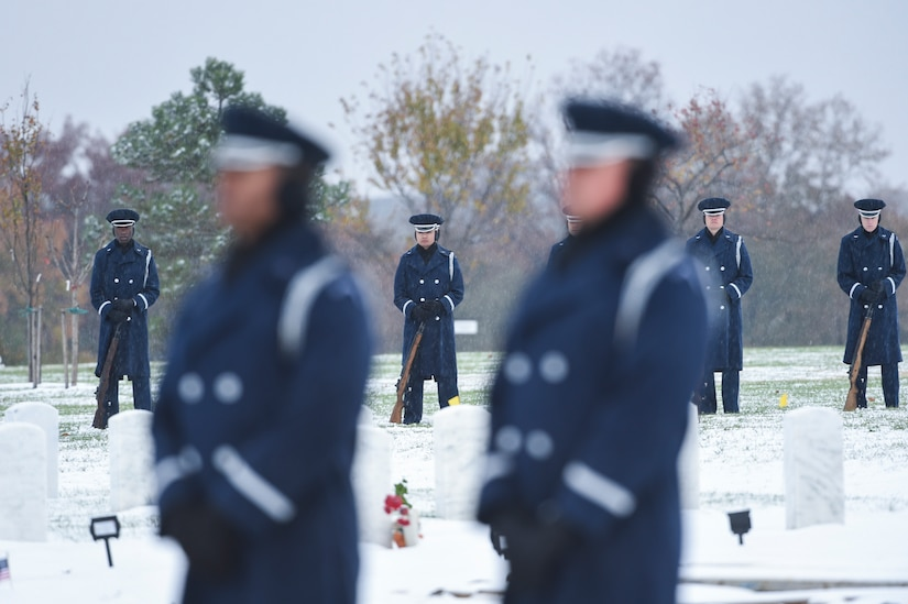 The U.S. Air Force firing party stand watch as Chief Master Sgt. Therese Henrion is laid to rest at Arlington National Cemetery, Nov. 15, 2018.