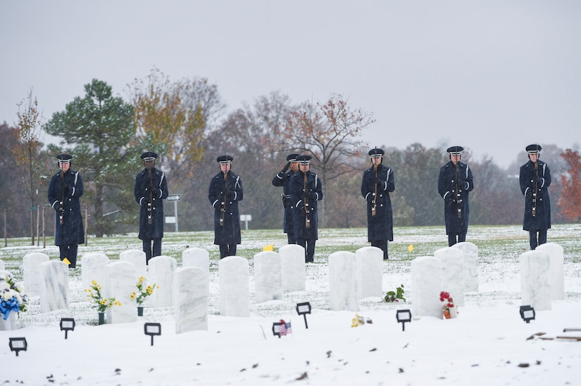 The U.S Air Force firing party perform a rifle salute in honor of the late Chief Master Sgt. Therese Henrion during an interment at Arlington National Cemetery, Nov. 15, 2018.