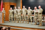 Soldiers from the Illinois Army National Guard's Bilateral Embedded Staff Team A22 are recognized during a mobilization ceremony Nov. 7, at the Illinois Military Academy in Springfield, Illinois. The six-person team from various parts of Illinois will embed with the Polish Military Contingent in Afghanistan in support of Operation Inherent Resolve. (U.S. Army photo by Sgt. 1st Class Bryan Spreitzer, Illinois National Guard Public Affairs)
