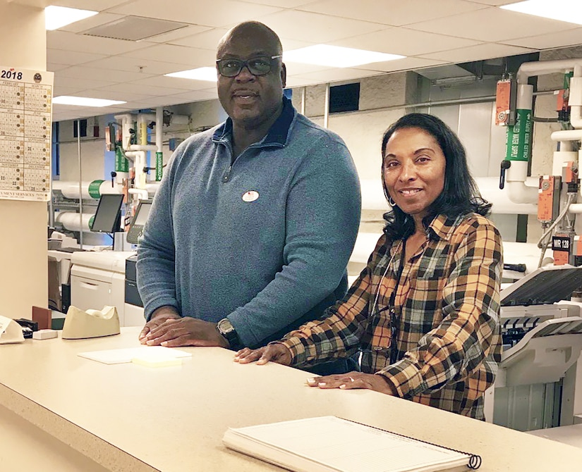 DLA Executive Print Facility employees Jackie Brown and Mischelle O'Neal work the counter at the White House printing complex in Washington, D.C.