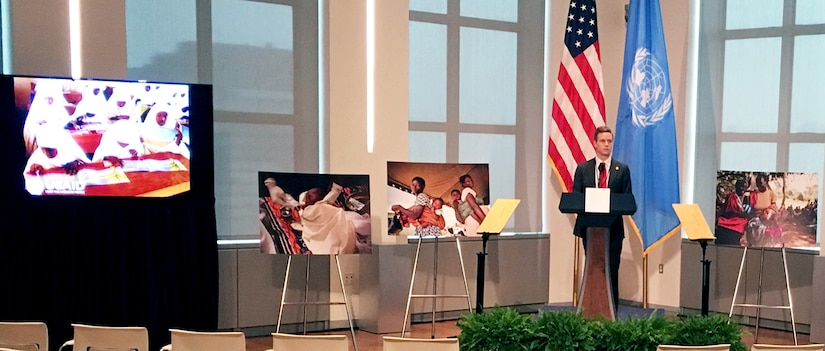 Large photos of children, printed at the DLA Executive Print Facility, surround the lectern where the first lady gave a speech supporting the Be Best campaign.