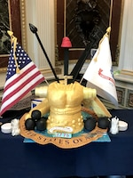 A cake for the White House observance of the Army birthday features flags produced in the DLA Executive Print Facility.