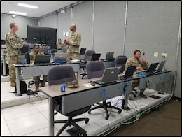 FORT KNOX, Ky. Soldiers from the Casualty Operations Division from the 14th Human Resources Sustainment Center (HRSC) reviews the casualty reporting flow. The 14th Human Resources Sustainment Center conducted a staff exchange (STAFFEX) at the Fort Knox Mission Control Training Center (MCTC) Dec 10-14.