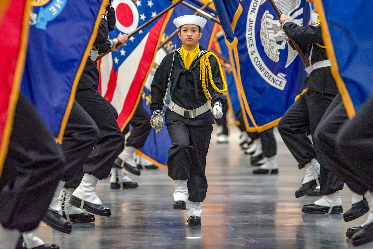 Navy performance division recruits carry state flags.