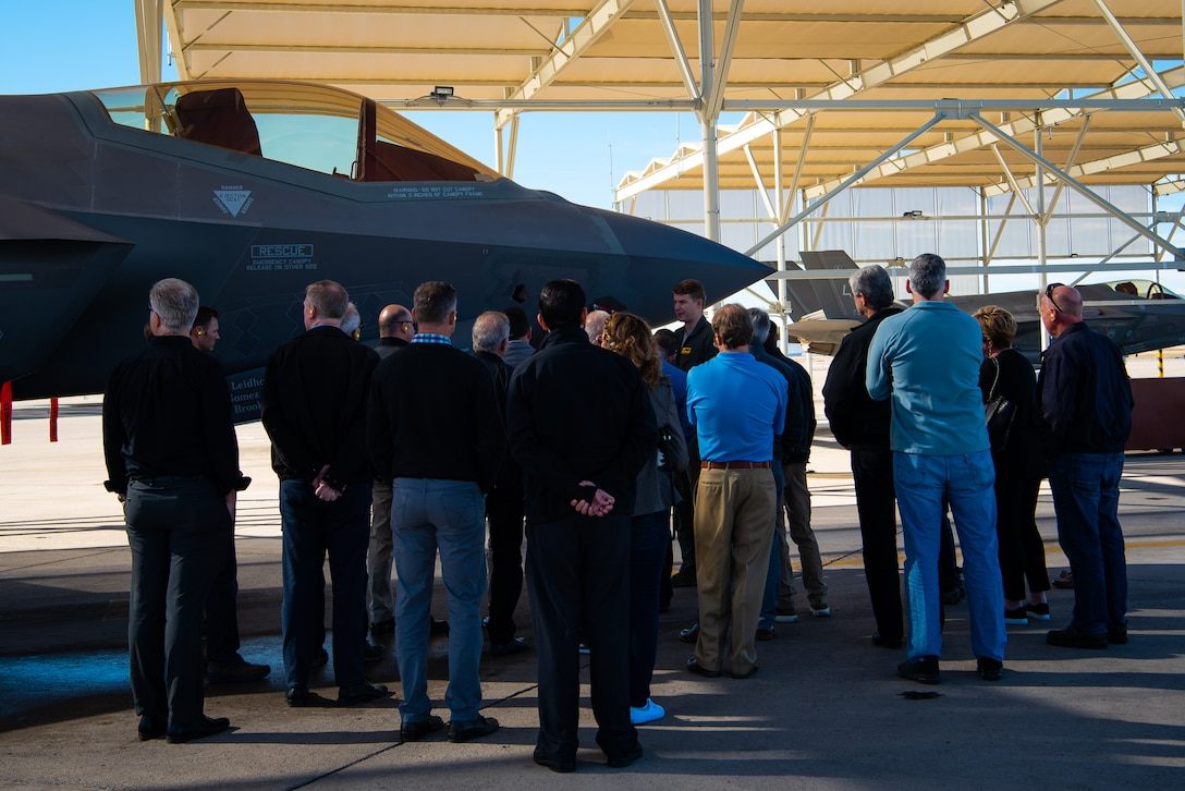Honorary Commanders receive a briefing on the F-35A Lightning II during a base tour at Luke Air Force Base, Ariz., Jan. 8, 2019.