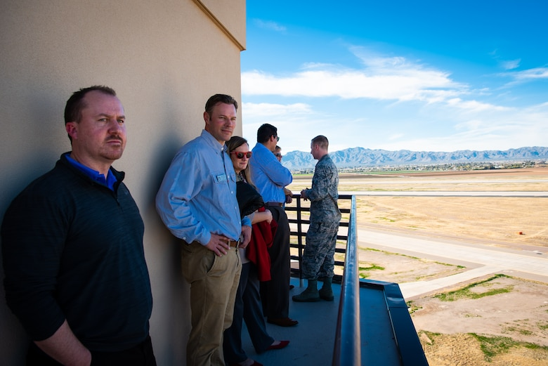 Honorary Commanders stand on top of the air traffic control tower during a base tour at Luke Air Force Base, Ariz., Jan. 8, 2019.
