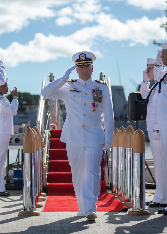 PEARL HARBOR (Jan. 08, 2019) - Capt. Richard Seif, commander of Submarine Squadron One, salutes the sideboys during a change of command ceremony on the submarine piers in Joint Base Pearl Harbor-Hickam, Jan. 08. (U.S. Navy photo by Mass Communication Specialist 2nd Class Melvin J. Gonzalvo)