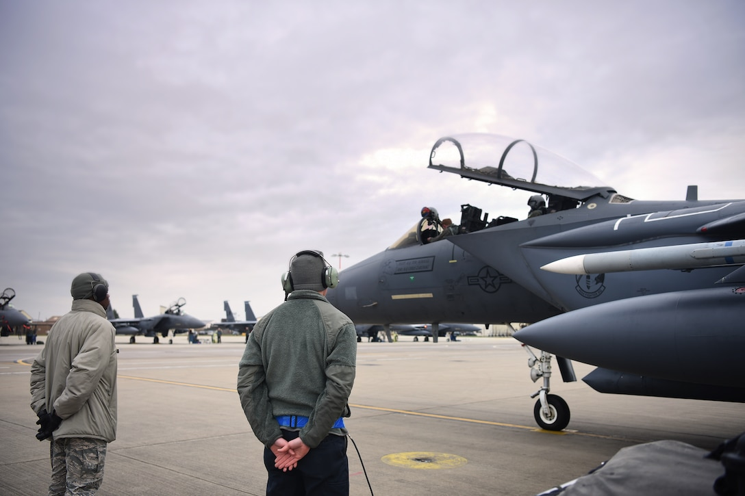 492nd Aircraft Maintenance Unit crew chiefs prepare to conduct aircraft launch procedures at Royal Air Force Lakenheath, England, Jan. 7, 2019.  492nd AMU Airmen maintain the world's premier multi-role fighter, the F-15E Strike Eagle to ensure RAF Lakenheath remains combat-ready. (U.S. Air Force photo by Airman 1st Class Shanice Williams-Jones)