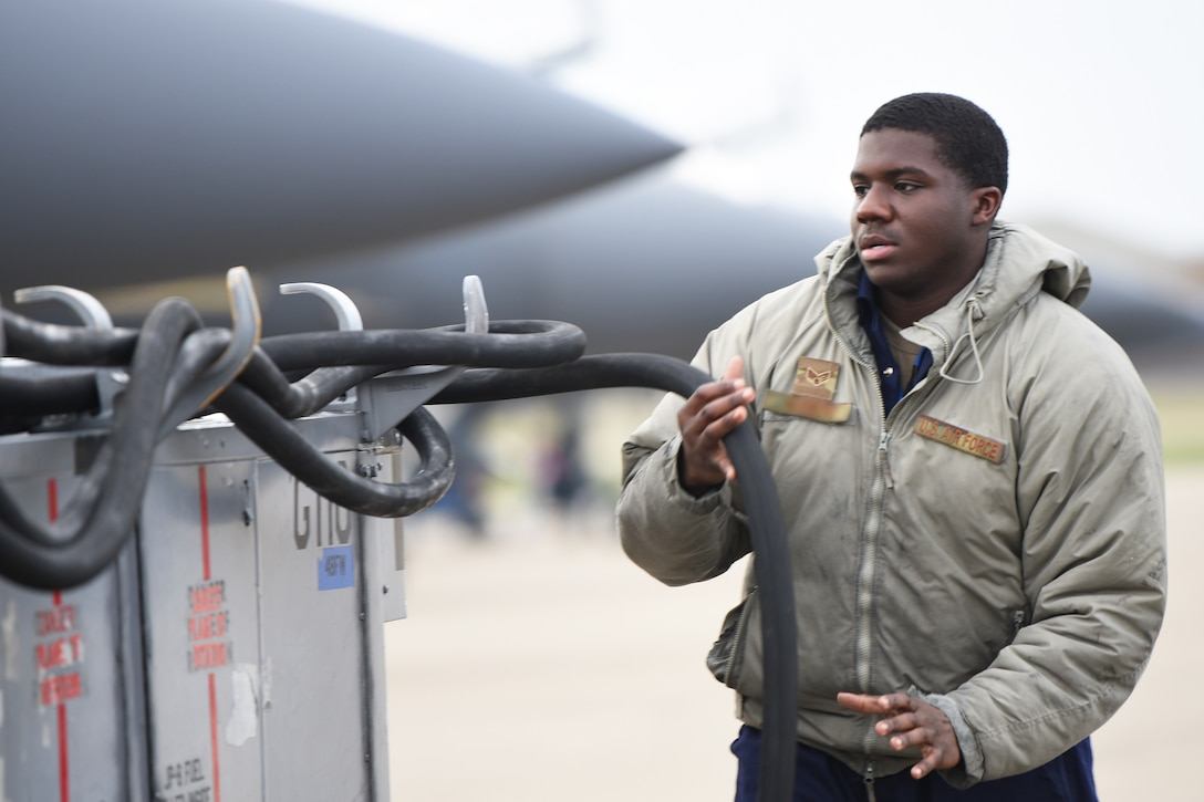 A 492nd Aircraft Maintenance Unit crew chief wraps up maintenance equipment after completing a functional inspection at Royal Air Force Lakenheath, England, Jan. 7, 2019. 48th Aircraft Maintenance Squadron Airmen maintain world's premier multi-role fighter, the F-15E Strike Eagle, to ensure RAF Lakenheath remains combat-ready. (U.S. Air Force photo by Airman 1st Class Shanice Williams-Jones)
