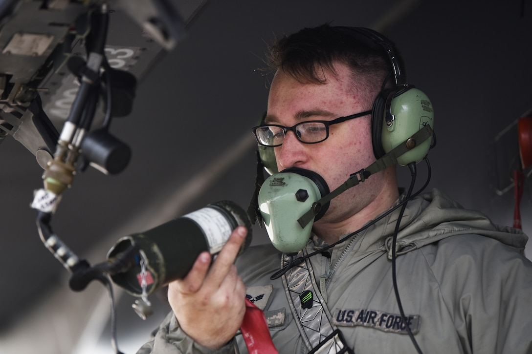 A 48th Aircraft Maintenance Squadron weapons load crew member conducts maintenance on an F-15E Strike Eagle at Royal Air Force Lakenheath, England, Jan. 7, 2019.  Diagnosing malfunctions and replacing damaged components is a key responsibility of AMXS personnel responsible for the care of the aircrafts. (U.S. Air Force photo by Airman 1st Class Shanice Williams-Jones)
