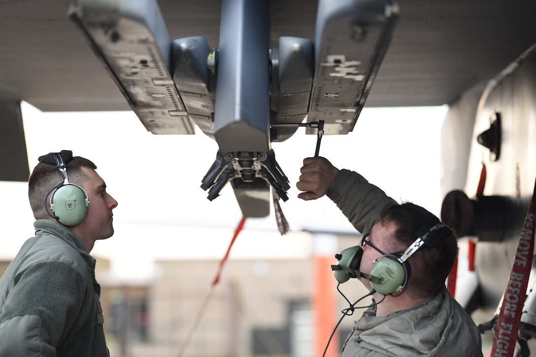 492nd Aircraft Maintenance Unit weapons load crew members conduct maintenance on an F-15E Strike Eagle pylon at Royal Air Force Lakenheath, England, Jan. 7, 2019. Aircraft maintainers work together in their respective specialties to ensure the Strike Eagles are always ready to fly. (U.S. Air Force photo by Airman 1st Class Shanice Williams-Jones)