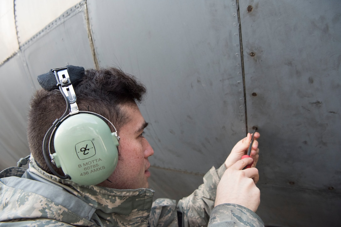 U.S. Air Force Staff Sgt. Brian Motta, 521st Air Mobility Operations Wing communications navigations journeyman, closes a door on a C-5M Super Galaxy aircraft after checking the auxiliary power unit oil Dec. 4, 2018, on Ramstein Air Base, Germany. This task was one of the approximately 1,000 tasks 141 students learned and trained on throughout the two week training exercise. (U.S. Air Force photo by Airman 1st Class Kristof J. Rixmann)