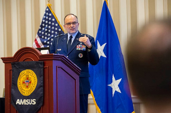 U.S. Air Force Maj. Gen. Lee Payne discusses MHS GENESIS at the 2018 AMSUS annual meeting. (Photo by MHS Communications)