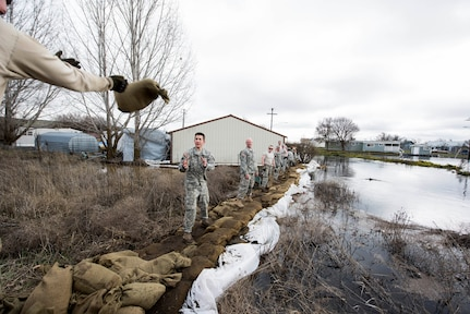 Airmen and Soldiers of the Washington National Guard assist with sandbagging during the 2017 flooding in Sprague, Wash.