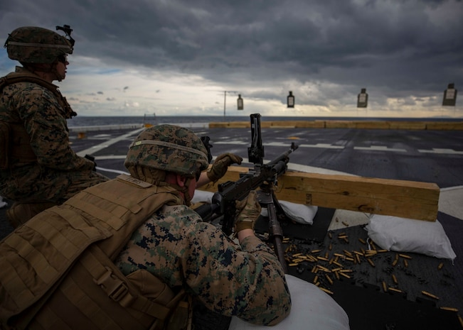 Marines with Battalion Landing Team, 1st Battalion, 2nd Marine Regiment, 22nd Marine Expeditionary Unit, fire M240B machine guns during a battle sight zeroing range on the flight deck of the USS Arlington (LPD 24) in the Mediterranean Ocean, Jan. 4, 2018. The USS Arlington is making a scheduled deployment as part of the 22nd MEU and the Kearsarge Amphibious Ready Group, in support of maritime security operations, crisis response and theatre security cooperation, while also providing a forward Naval and Marine presence.