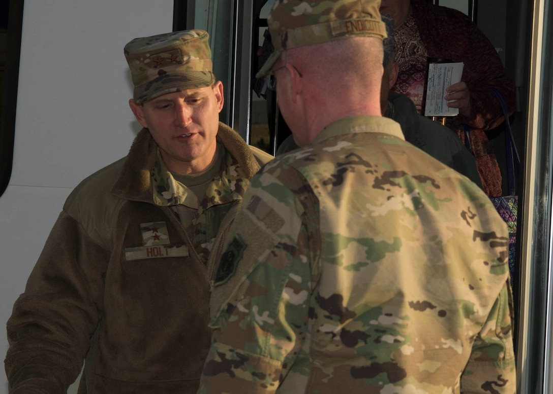Maj. Gen. Cameron Holt, Deputy Assistant Secretary for Contracting, Office of the Assistant Secretary of the Air Force for Acquisition, Technology and Logistics, is greeted by Col. Troy L. Endicott, 460th Space Wing commander, at Buckley Air Force Base, Colo., Jan. 9, 2019. During his visit,  Holt received a mission brief met with 460th Contracting Flight Airmen.  (U.S. Air Force photo by Senior Airman Codie Collins)
