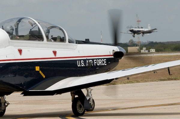 An instructor pilot and student from the 559th FTS taxi a T6 Texan II aircraft toward the runway at Joint Base San Antonio-Randolph, Texas August 19, 2009. (Photo by Joel Martinez)