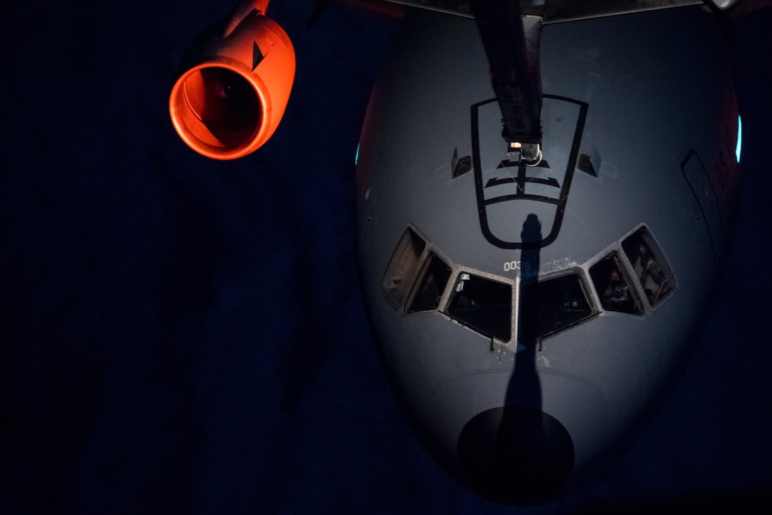 A U.S. Air Force KC-10 Extender aircraft from the 6th Air Refueling Squadron conducts aerial refueling training with another KC-10 from the 9th ARS over California, Oct. 24, 2018. Travis Airmen conduct training events to stay current and be prepared for future mobility operations. (U.S. Air Force Photo by Master Sgt. Joseph Swafford)