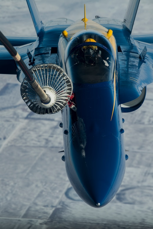 A U.S. Air Force KC-10 Extender, crewed by Reserve Citizen Airmen with the 78th Air Refueling Squadron, 514th Air Mobility Wing, extends a drogue to refuel an F-18 piloted by the U.S. Navy Flight Demonstration Team, the Blue Angels, over the mid-western U.S., January 3, 2018.