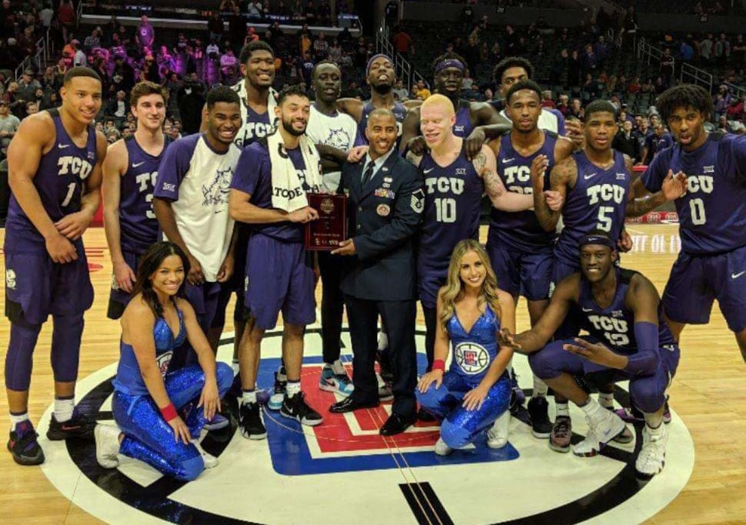 Master Sgt. Marcus Heard, a recruiter at March Air Reserve Base, poses with the championship winning TCU Horn Frogs basketball team, after they took home the Air Force Reserve Naismtih Hall of Fame Basketaball Hall of Fame Classic title in Los Angeles. Recruiters were asked to help present the MVP and championship trophies at all of the tournament AFRC sponsored. (Courtesy photo)