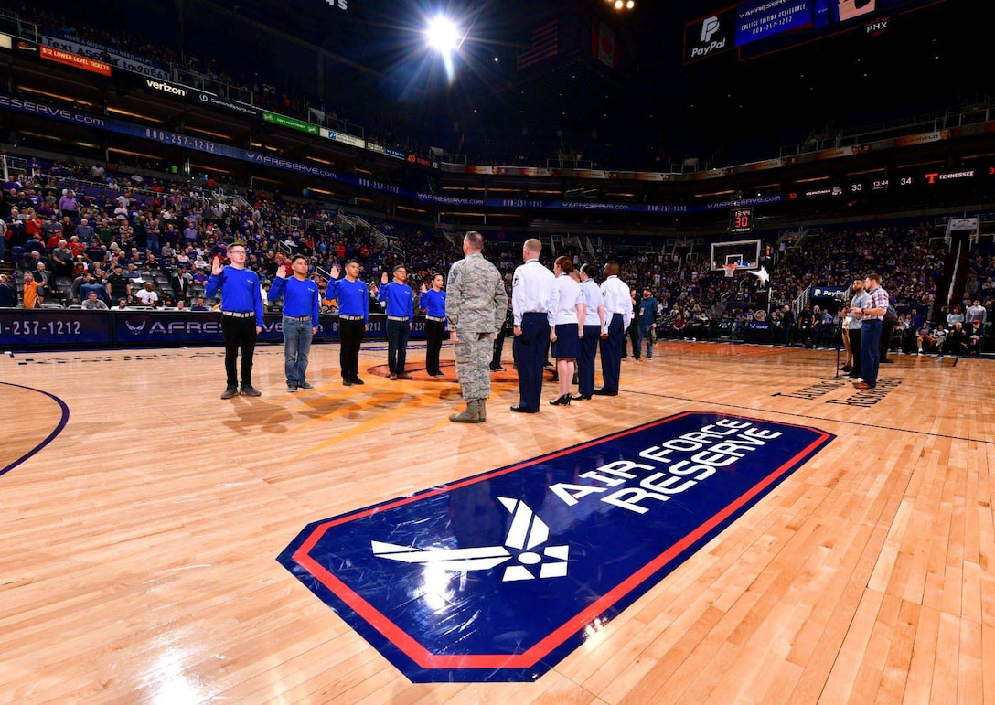 A mass enlistment was held by Team Luke at the Air Force Reserve Jerry Colangelo Classic basketball tournament in Phoenix. A group of 10 future Citizen Airman took part in the enlistment conducted by Col. Robert Tofil, the 944th Fighter Wing vice commander. (Courtesy photo)