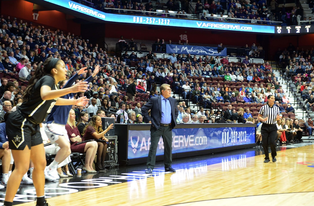 UConn Head Coach Geno Auriemma, paces the sidelines during the Air Force Reserve Women's Holiday Showcase at the Mohegan Sun Arena in Connecticut. Auriemma is an 11 time national champion coach with the Huskies, led his team in defeating Vanderbilt 80-42 in front of more than 7,500 fans. (Air Force photo/Master Sgt. Chance Babin)