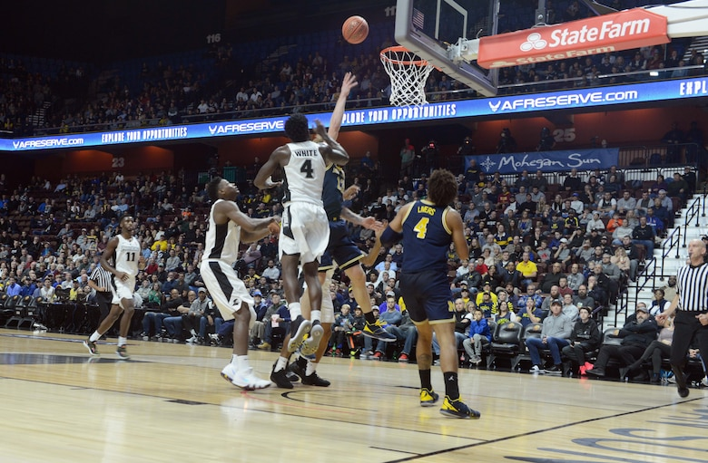 Michigan's Ignas Brazdeikis drives through the lane during the championship game against Providence in the Air Force Reserve Tip-Off Tournament at the Mohegan Sun Arena, Connecticut. The game was nationally televised on ESPN and featured prominant Air Force Reserve branding at the arena and on television. (Air Force photo/Master Sgt. Chance Babin)
