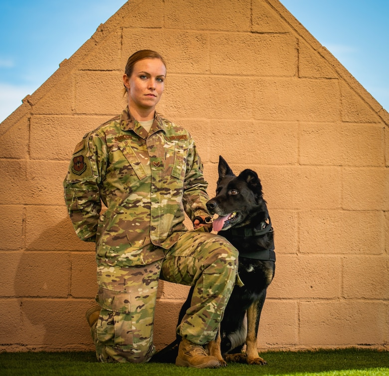 Senior Airman Amber Gordon, 56th Security Forces Squadron military working dog handler, poses for a portrait with her MWD, Boss, at Luke Air Force Base, Ariz., Jan. 7, 2019. The MWD handler is responsible for protecting and defending military installations with their loyal canine partner by their side. (U.S. Air Force photo by Senior Airman Alexander Cook)