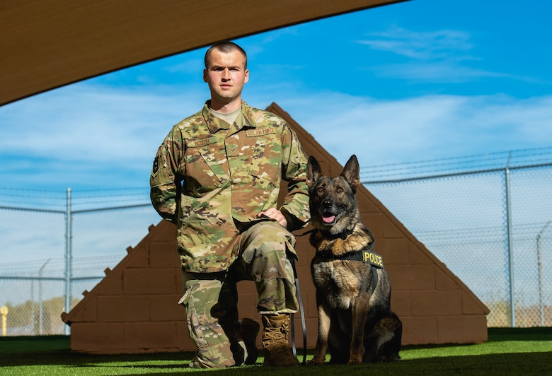 Senior Airman Zachory Boozel, 56th Security Forces Squadron military working dog handler, poses with his MWD, DC, at Luke Air Force Base, Ariz., Jan. 7, 2019. MWD's and their handlers protect approximately 7,000 personnel at Luke. (U.S. Air Force photo by Senior Airman Alexander Cook)