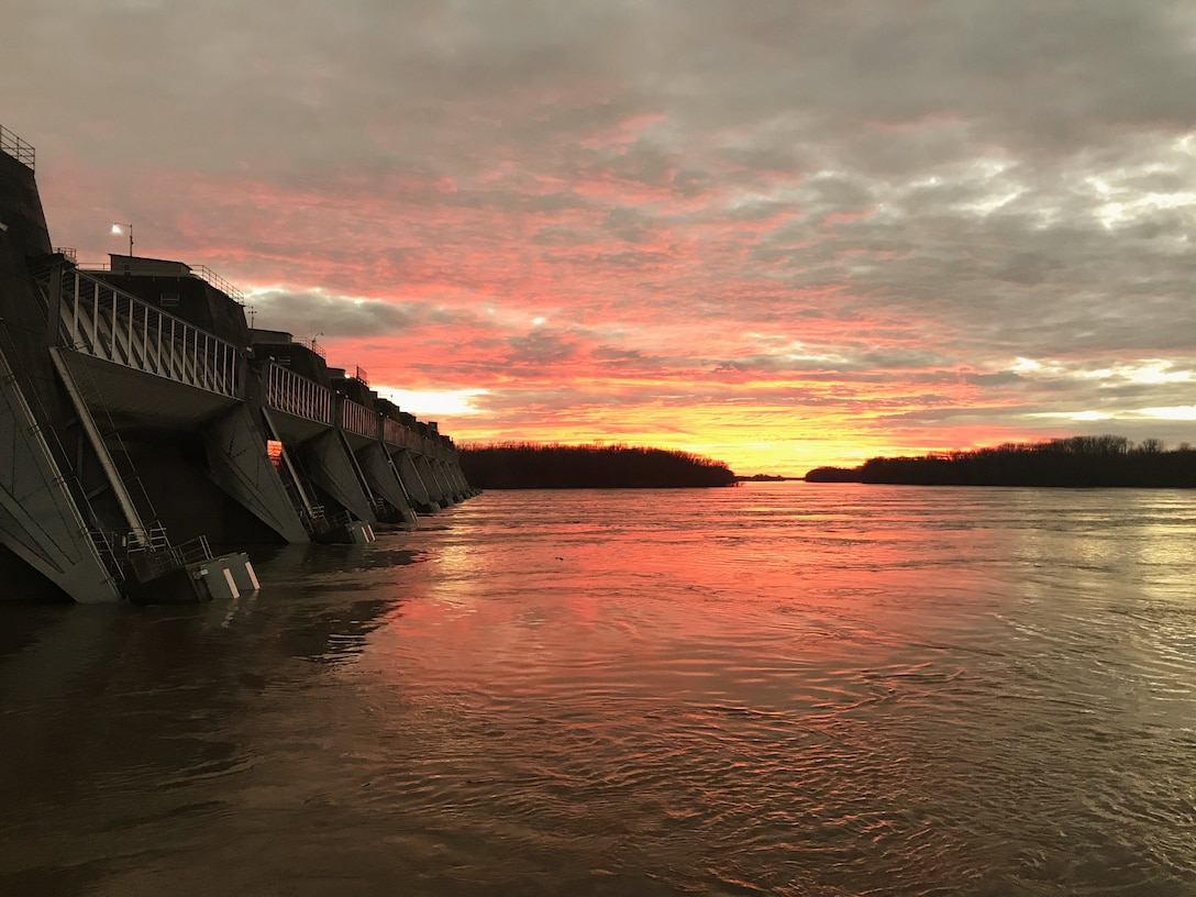 The sun sets over the Ohio River at John T. Myers Locks and Dam in Mt. Vernon, Indiana.