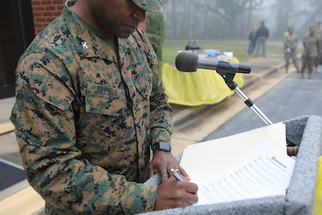 Col. Alphonso Trimble, commanding officer, Marine Corps Logistics Base Albany, signed a stalking awareness proclamation in front of Marines, civilians and several community groups at a ceremony Tuesday in front of the Base Chapel Annex.  Following the reading of the proclamation, there was a quick break and then a detailed training session inside the Chapel.