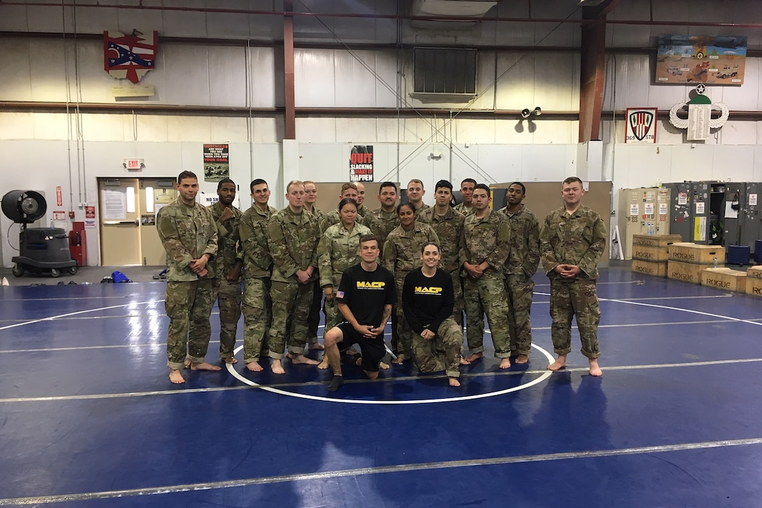 Combatives class with instructors