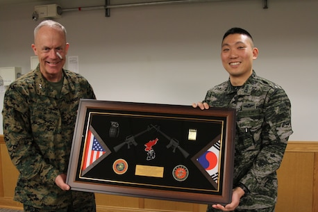 CAMP HUMPHREYS, Republic of Korea – Maj. Gen. Patrick J. Hermesmann, U.S. Marine Corps Forces Korea commander, presents Capt. Jaewon Choi, Republic of Korea Marine Corps liaison officer to the U.S. Marine Corps, a token of appreciation for his work with MARFORK here, Jan. 8. Choi's job at MARFORK was a vital link between the unit and the R.O.K. Marine corps and served to strengthen the alliance between the services and countries alike. (Official U.S. Marine corps photo by Sgt. Nathaniel Hanscom)