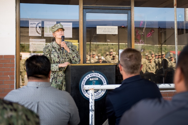 TINIAN, Commonwealth of the Northern Mariana Islands (Jan. 9, 2019) Rear Adm. Shoshana Chatfield, commander Joint Region Marianas and Task Force West, addresses attendees during a relief-in-place and transfer of authority ceremony. Naval Mobile Construction Battalion 3, Detachment Tinian, assumed responsibility as command element for Joint Task Group Engineer from Naval Mobile Construction Battalion 1, Detachment Guam. Service members from Joint Region Marianas and U.S. Indo-Pacific Command are providing Department of Defense support to the Commonwealth of the Northern Mariana Islands' civil and local officials as part of the Federal Emergency Management Agency-supported Super Typhoon Yutu recovery efforts. (U.S. Navy photo by Mass Communication Specialist 2nd Class Kelsey J. Hockenberger)