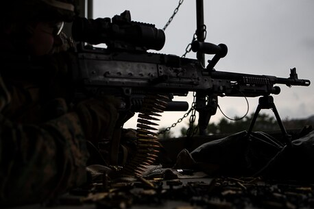 Pfc. Trenton Jones, a machine gunner with Charlie Company, Battalion Landing Team, 1st Battalion, 4th Marines, fires an M240B medium machine gun during training at Camp Hansen, Okinawa, Japan, Jan. 9, 2019.