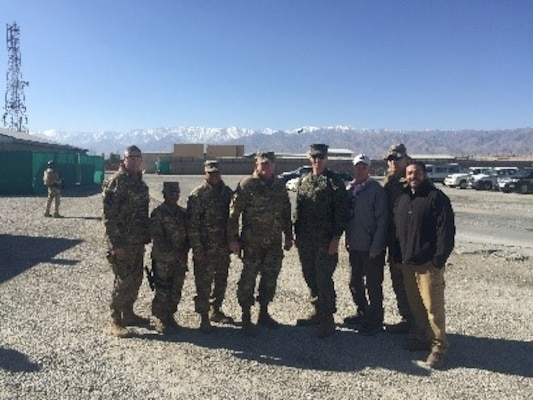 Roberto Santana Irizarry, far right, contracting officer representative, DLA Troop Support Subsistence supply chain, accompanies Army Brig. Gen. Mark Simerly, center, DLA Troop commander and his military staff during a visit to the ANHAM Warehouse in Afghanistan, January 2018. Santana Irizarry was awarded the DLA Troop Support Leader of the Year for his support to the warfighter in Afghanistan.