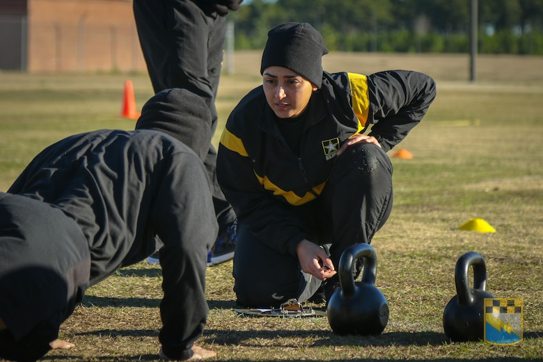 Staff Sgt. Idis Arroyo, assigned to Alpha Company, 519th Military Intelligence Battalion, 525th Military Intelligence Brigade, grades a Soldier on the hand release push-ups event during the field testing of the Army Combat Fitness Test at Fort Bragg, N.C. on January 9, 2019. Beginning October 2020, all Soldiers will be required to take the new gender- and age-neutral test.